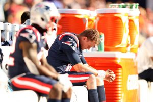 sideline Patriots x Saints